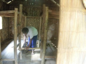 Repairs. Sir Poloy fixing hut #38-4.